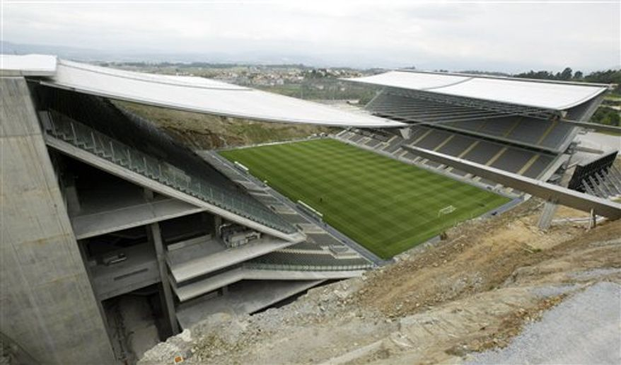 FILE - In this April 16, 2004 file photo, a soccer stadium built by Portuguese architect Eduardo Souto de Moura, is seen in the city of Braga, Portugal, where the European soccer championship was held in 2004. Souto de Moura, 58, whose buildings are praised for their careful use of natural materials and their unexpected dashes of color, has won the 2011 Pritzker Architecture Prize, the prize's jury announced Monday, March 28, 2011. (AP Photo/Paulo Duarte, File)
