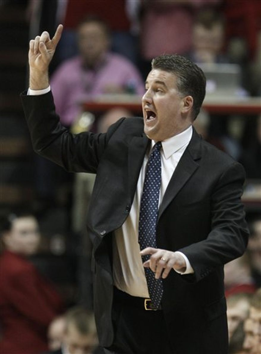 FILE - This Feb. 23, 2011, file photo shows Purdue coach Matt Painter giving instructions during the second half of an NCAA college basketball game against Indiana in Bloomington, Ind. Painter has had one of the most successful runs in school history. It looks like he's about to cash in.  Painter will meet with Missouri officials regarding their vacant head coaching position. However, Purdue said in a statement that it is committed to keeping him. (AP Photo/Darron Cummings, File)