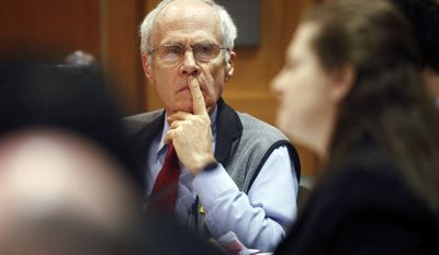 Wisconsin Secretary of State Doug La Follette listens to Assistant Attorney General Maria Lazar make her opening arguments at a hearing in front of Dane County Circuit Judge Maryann Sumi at the Dane County Courthouse in Madison, Wis., Tuesday, March 29, 2011. (AP Photo/Michael P. King, Pool)