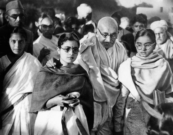 ** FILE ** Mahatma Gandhi is seen in 1948 with two of his disciples. A state in western India has banned author Joseph Lelyveld's new book, which some reports have said i
