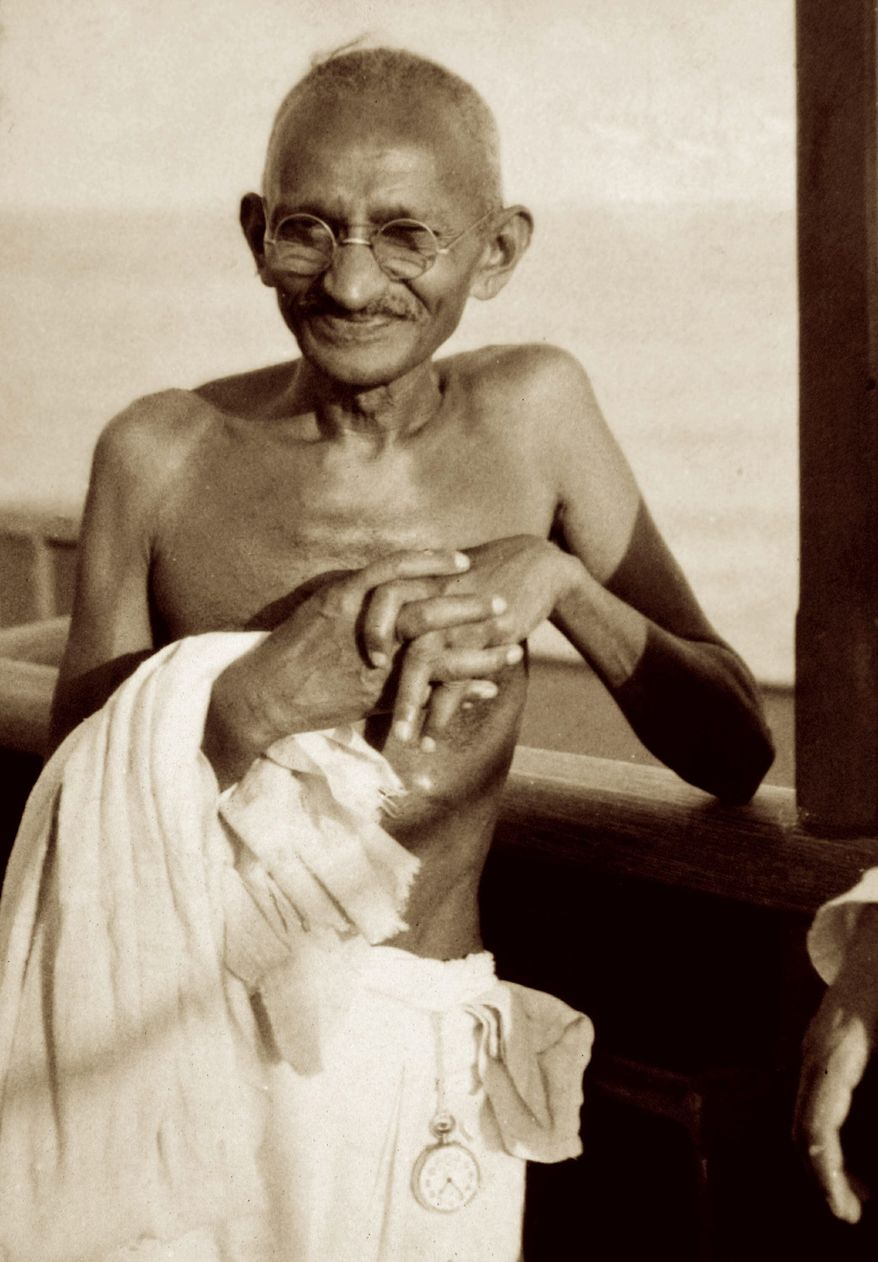 """Mahatma Gandhi is seen traveling to London by ship in 1931 for a conference on dominion status for India. A new book, """"Great Soul: Mahatma Gandhi and His Struggle With India,"""" has caused an uproar because reports about the book, not yet available in India, claim it indicates Gandhi had a gay lover. (Associated Press)"""