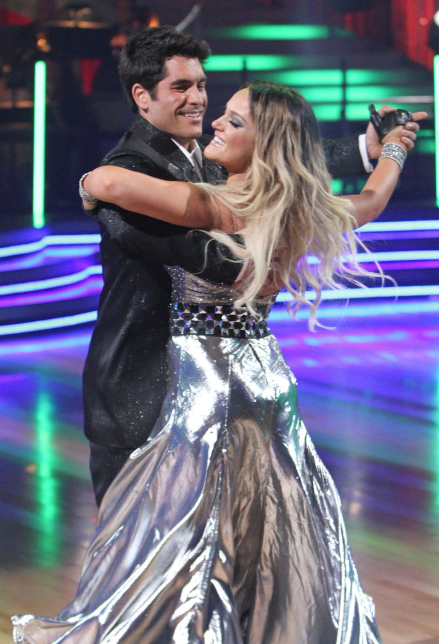 "Radio personality Mike Catherwood and Lacey Schwimmer perform on ""Dancing With the Stars."" (ABC via Associated Press)"