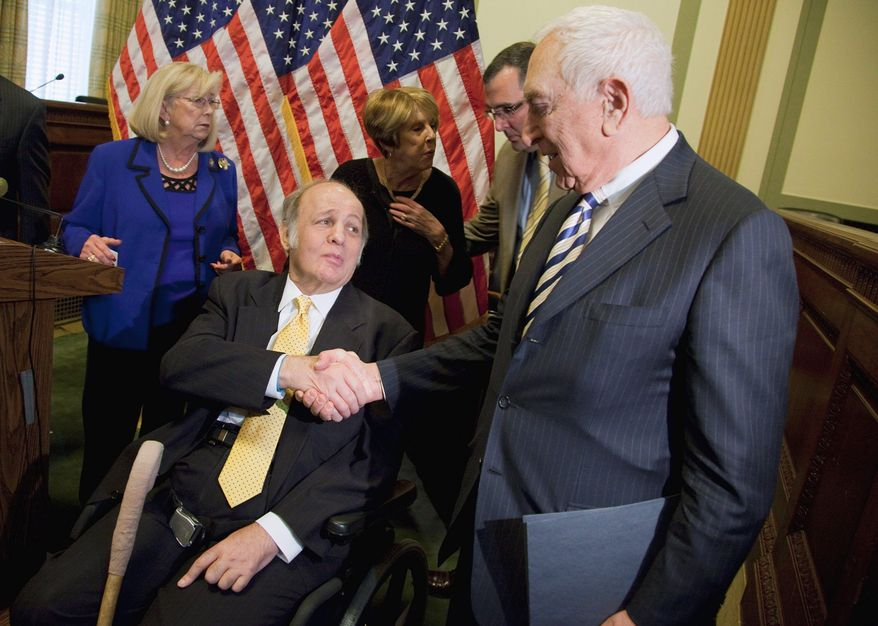 Former White House press secretary James Brady, who was left paralyzed in President Reagan's assassination attempt, visits lawmakers on Capitol Hill on Wednesday, the 30th anniversary of the shooting. (Associated Press)