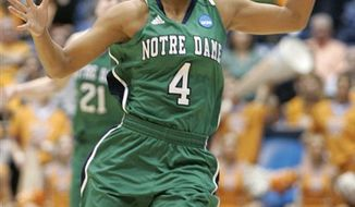Notre Dame guard Skylar Diggins celebrates in the closing minute of Notre Dame's 73-59 win over Tennessee in an NCAA women's college basketball tournament regional final, Monday, March 28, 2011 in Dayton, Ohio. Diggins led Notre Dame with 24 points. (AP Photo/Skip Peterson)