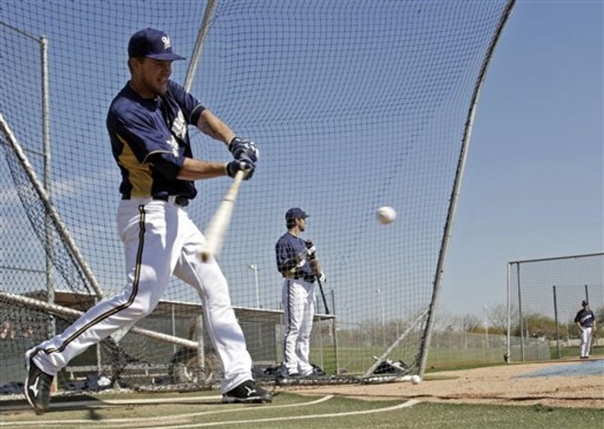 FILE - This Feb. 24 file photo shows Milwaukee Brewers' Corey Hart tossing a ball during the team's photo day in Phoenix. Hart's spring has been far from perfect after an injury has limited him in camp. He's just been thankful this season that his role is secure. (AP Photo/Morry Gash, File)
