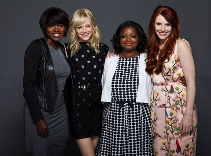 "Actors, from left, Viola Davis, Emma Stone, Octavia Spencer and Bryce Dallas Howard, from the film, ""The Help,"" pose for a portrait backstage at CinemaCon, the official convention of the National Association of Theater Owners on Tuesday, March 29, 2011, in Las Vegas.  (AP Photo/Eric Jamison)"