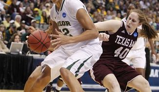 Baylor center Brittney Griner (42) is defended by Texas A&M forward Kelsey Assarian (40) during the first half of an NCAA women's college basketball tournament regional final, Tuesday, March 29, 2011, in Dallas. (AP Photo/LM Otero)