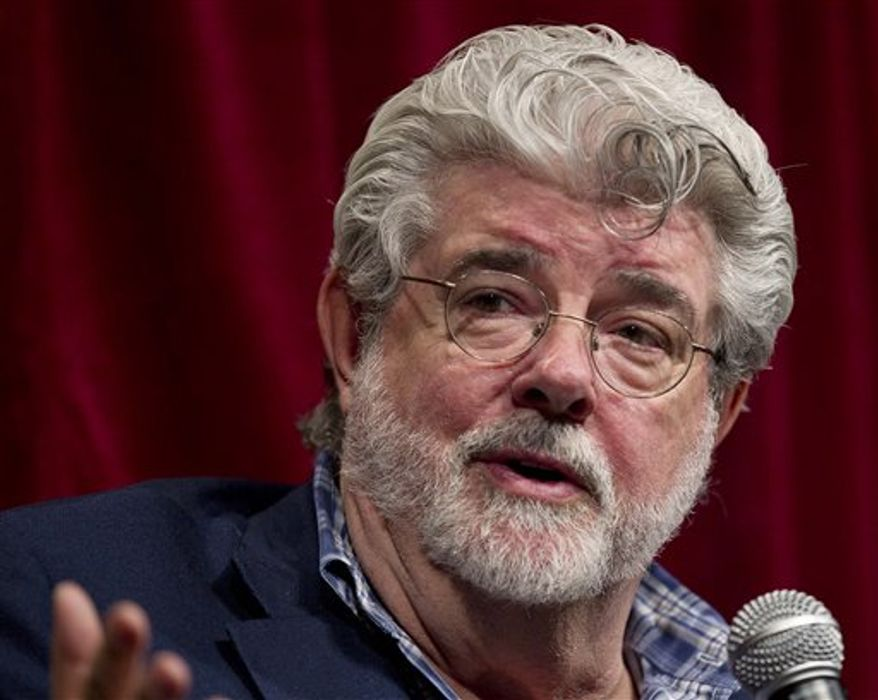 George Lucas, second from right, talks about digital filmmaking as RealD CEO and chairman Michael Lewis, left, James Cameron, second from left, and Jeffrey Katzenberg look on during a panel discussion at teh CinemaCon convention, Wednesday, March 30, 2011, in Las Vegas. (AP Photo/Julie Jacobson)