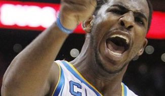 New Orleans Hornets' Chris Paul celebrates a win at the end of the fourth quarter of an NBA basketball game against the Phoenix Suns Friday, March 25, 2011, in Phoenix.  The Hornets defeated the Suns 106-100. (AP Photo/Ross D. Franklin)