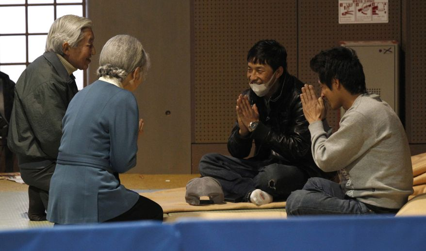 Japanese Emperor Akihito (left) and Empress Michiko speak with evacuees at a center in Tokyo on Wednesday, March 30, 2011. The royal couple visited the shelter to give encouragement to some 300 evacuees from the March 11 earthquake and tsunami, mostly from Fukushima Prefecture, where the troubled Fukushima Dai-ichi nuclear power plant is located. (AP Photo/Issei Kato, Pool)