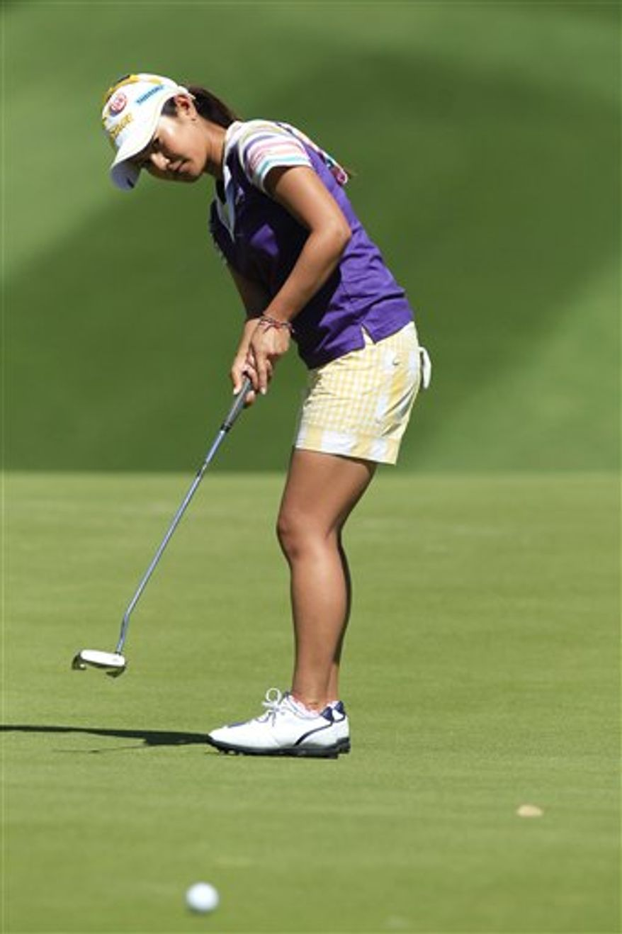 Ai Miyazato of Japan, watches a practice putt on the 10th hole during the pro-am round of the LPGA Kraft Nabisco Championship golf tournament  in Rancho Mirage, Calif., Wednesday, March 30, 2011. (AP Photo/Chris Carlson)
