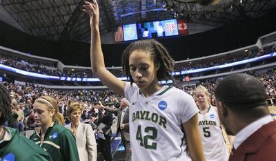 Texas A&M Danielle Adams (23), Sydney Carter, center, and  Sydney Colson, left, celebrate after Texas A&M beat Baylor 58-46 to win the NCAA women's college basketball tournament regional final, Tuesday, March 29, 2011, in Dallas. (AP Photo/LM Otero)