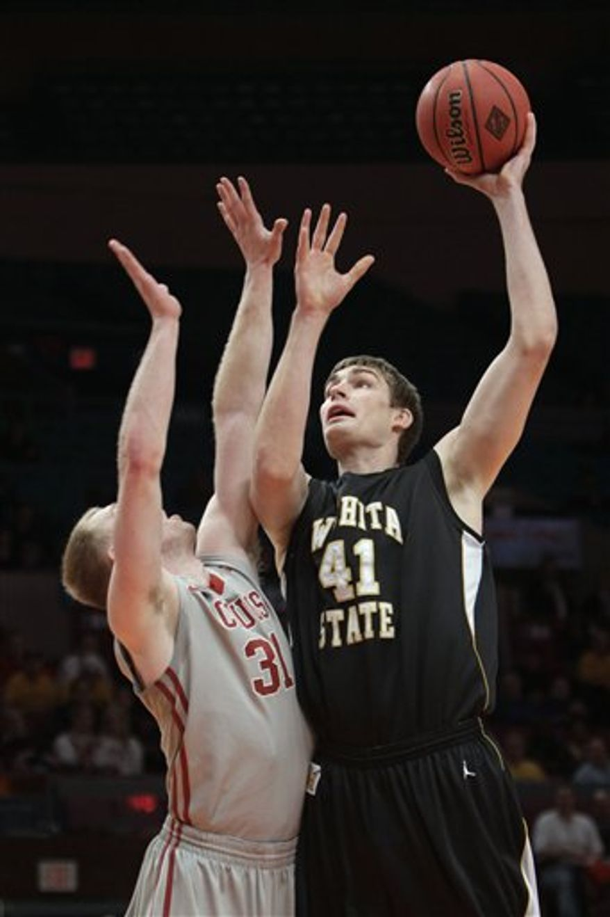 Wichita State's Gabe Blair (32) fouls Washington State's DeAngelo Casto in the second half of a semifinal in the NIT college basketball tournament, Tuesday, March 29, 2011, at Madison Square Garden in New York. Wichita State won 75-44. (AP Photo/Mary Altaffer)