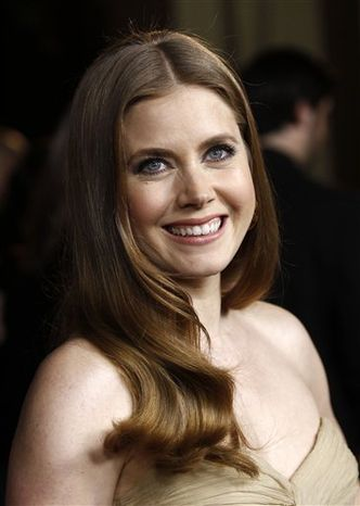 FILE - In this Jan. 29, 2011 file photo, actress Amy Adams arrives at the 63rd annual  DGA Awards in Los Angeles. (AP Photo/Matt Sayles, file)