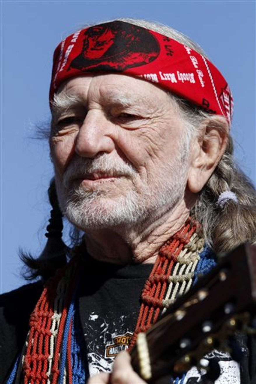 FILE - In this Nov. 7, 2010 photo, Willie Nelson performs before the start of the NASCAR AAA Texas 500 auto race at Texas Motor Speedway, in Fort Worth, Texas. (AP Photo/Tim Sharp, File)