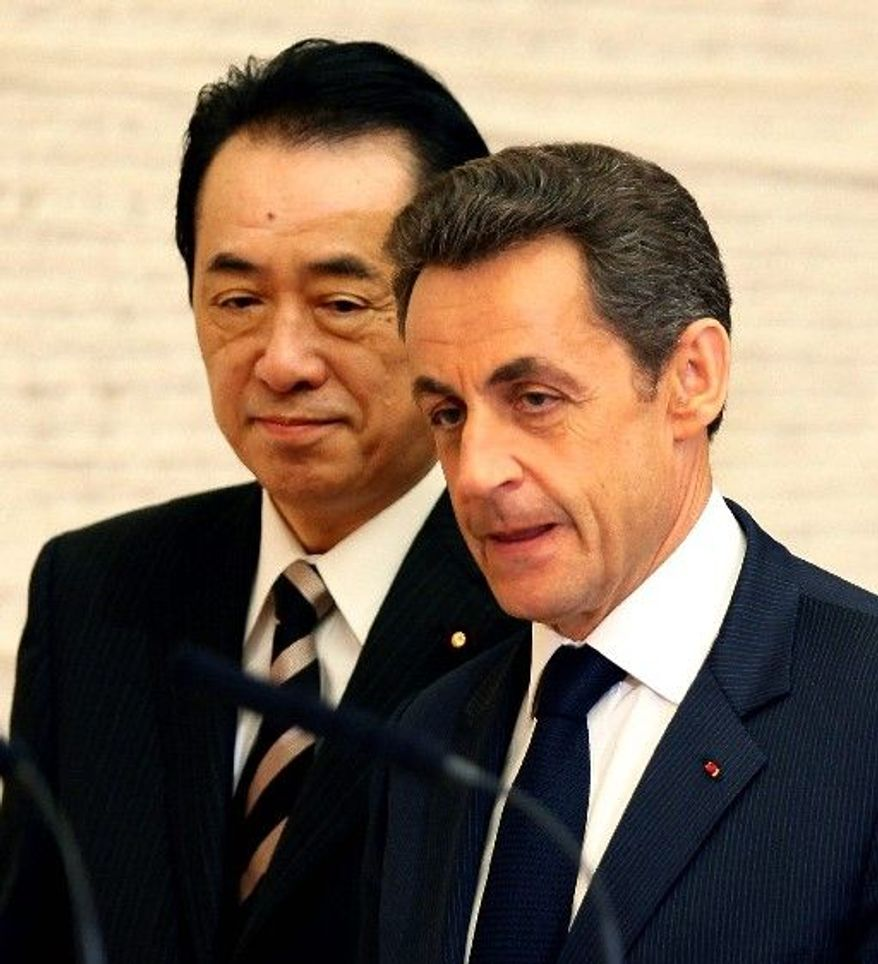 French President Nicolas Sarkozy and Japanese Prime Minister Naoto Kan speak about nuclear power safety after their meeting in Tokyo on Thursday. (Associated Press)