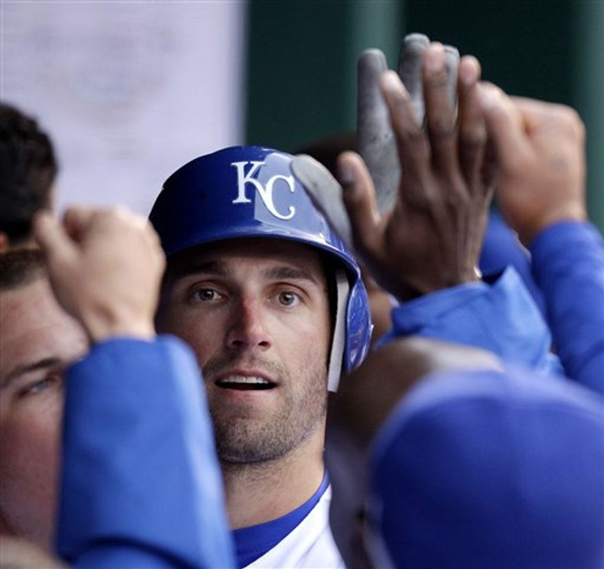 Kansas City Royals' Matt Treanor (15) hits a three-run home run during the 13th inning of an MLB baseball game against the Los Angeles Angels in Kansas City, Mo., Sunday, April 3, 2011. The Royals defeated the Angels 9-12. (AP Photo/Orlin Wagner)