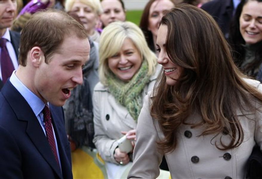 FILE - In this Tuesday, March 8, 2011 file photo, Britain's Prince William and Kate Middleton prepare to flip pancake at a display by the charity Northern Ireland Cancer Fund for Children outside the City Hall in Belfast, Northern Ireland. Prince William might seem like someone who has it all: royal status, a charming fiancee, good health, and an easy touch with his future subjects. But there is something he lacks: A full head of hair. Casual observers who have not paid much attention to the future king during the years before his engagement to Kate Middleton have been surprised by the extent of his hair loss, particularly since younger brother Prince Harry still sports a luxuriant supply of tousled red hair. (AP Photo/Peter Morrison, File)