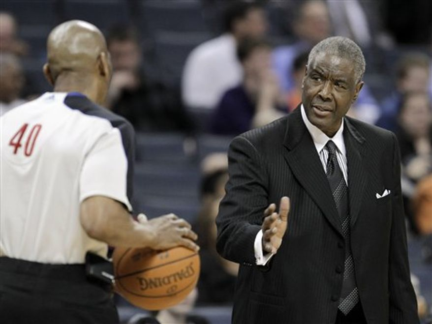 Charlotte Bobcats' Paul Silas, right, argues a call with referee Leon Wood in the first half of the Bobcats' 98-97 win over the Cleveland Cavaliers in an NBA basketball game in Charlotte, N.C., Wednesday, March 30, 2011. (AP Photo/Chuck Burton)