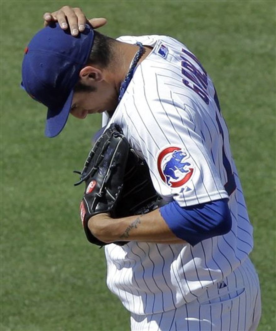 Chicago Cubs pitcher Matt Garza adjusts his cap after giving up his second walk of the fourth inning of a spring training baseball game against the Arizona Diamondbacks, Tuesday, March 29, 2011, at HoHoKam Stadium in Mesa, Ariz. (AP Photo/Matt York)