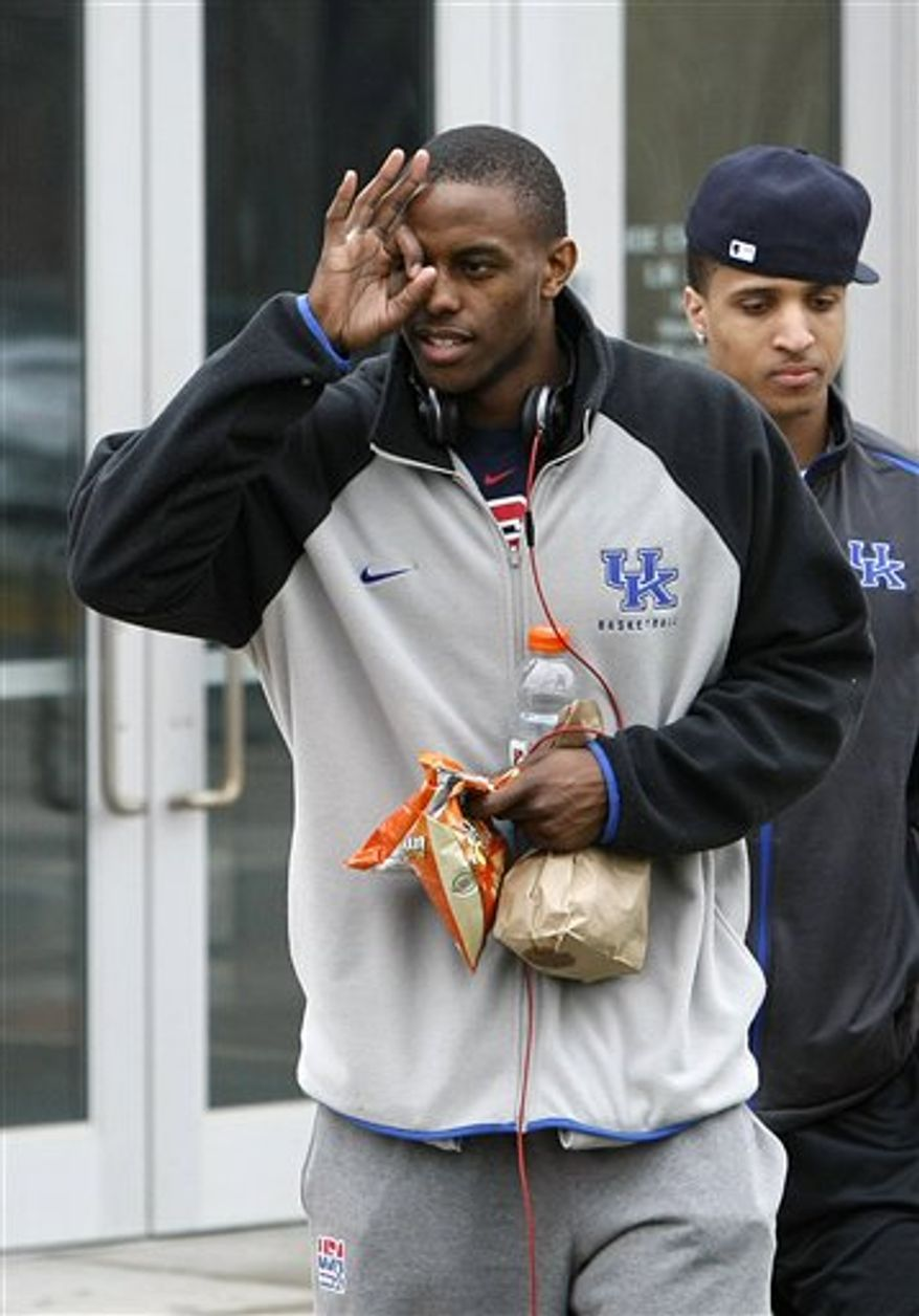 Kentucky's Darius Miller gives the three-pointer sign to fans as his team prepares to depart for the Final Four in Lexington, Ky., Wednesday, March 30, 2011.  (AP Photo/Ed Reinke)