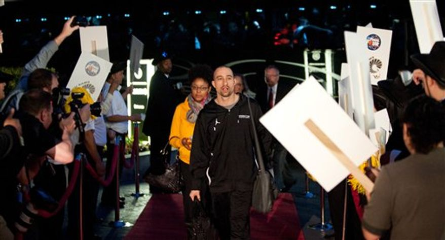 Virginia Commonwealth head coach Shaka Smart arrives at the team hotel in Houston, Texas. The Rams will participate in the school's first-ever Final Four on Saturday, April 2. (AP Photo/VCU, Scott K. Brown)