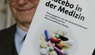 In this Wednesday, March 30, 2011 photo, Dr. Peter Scriba, chairman of the German Medical Association's advisory board, poses in Munich, southern Germany. For German patients plagued with problems like chronic pain and mild depression, doctors may soon be trying something a little different: a placebo. After completing a major study on the use of placebos, the German Medical Association recently concluded the fake pills sometimes work better than real medicines and recommended that doctors give them out more often even without explicitly telling their patients. (AP Photo/Matthias Schrader)