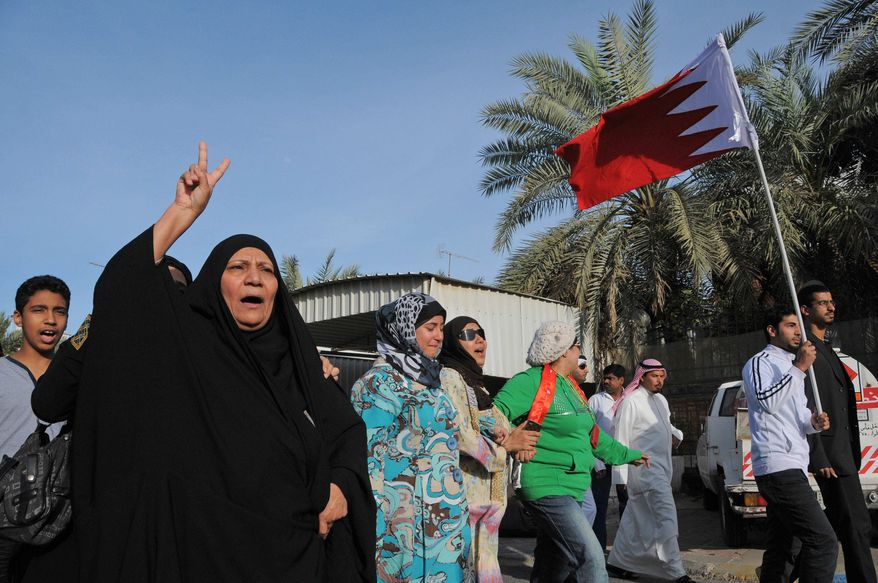 ** FILE ** Demonstrators protest the violence in Bahrain near Bahrain's embassy in Kuwait in Surra, Kuwait, on Wednesday, March 16, 2011. (AP Photo/Gustavo Ferrari)