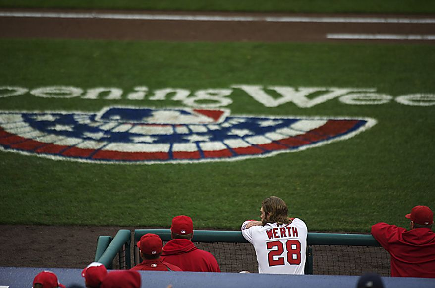Jayson Werth watches the game from the dug out in the bottom of the ninth inning the Washington Nationals host the Atlanta Braves on Opening Day at Nationals Park in Washington, D.C., Thursday, March 31, 2011. (Rod Lamkey Jr/The Washington Times)