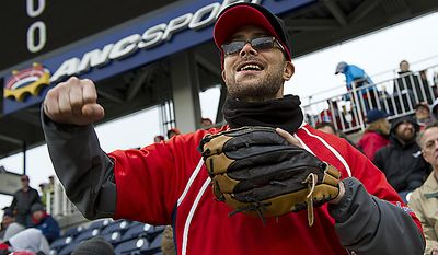 Russell March of Washington, D.C. cheers as the Nationals make a play on opening day, Thursday, March 31, 2011 at Nationals Park in Washington, D.C. (Barbara L. Salisbury/The Washington Times)