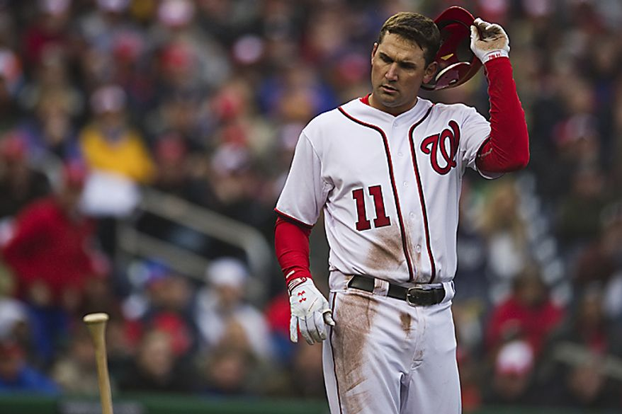 Ryan Zimmerman tosses his bat after striking out looking at a Derek Lowe pitch during the third inning of the opening day game against the Atlanta Braves at Nationals Park, in Washington, D.C., Thursday, March 31, 2011. (Drew Angerer/The Washington Times)
