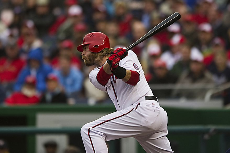 Jayon Werth connects for a base hit in his first at bat with the Nationals during the first inning of the opening day game against the Atlanta Braves at Nationals Park, in Washington, D.C., Thursday, March 31, 2011. (Drew Angerer/The Washington Times)