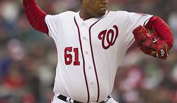 Nationals starting pitcher Livan Hernandez delivers a pitch during the first inning of the opening day game against the Atlanta Braves at Nationals Park, in Washington, D.C., Thursday, March 31, 2011. (Drew Angerer/The Washington Times)