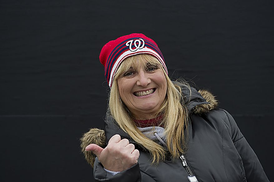 Maria Llorente, who recently moved to Washington, D.C., from Florida, attends her first Nationals opening day Thursday, March 31, 2011 at Nationals Park in Washington, D.C. (Barbara L. Salisbury/The Washington Times)