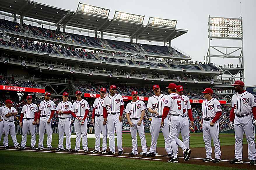 Nationals manager Jim Riggleman greets his players on the field at the start of the opening day game against the Atlanta Braves at Nationals Park, in Washington, D.C., Thursday, March 31, 2011. (Drew Angerer/The Washington Times)