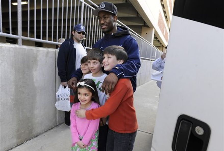 Connecticut's Tiffany Hayes waves as she leaves Gampel Pavilion to boards a bus for the airport in Storrs, Conn., en route to Indianapolis, Thursday, March 31, 2011.  Connecticut will face Notre Dame in NCAA Final Four Game in Indianapolis Sunday.  (AP Photo/Jessica Hill)