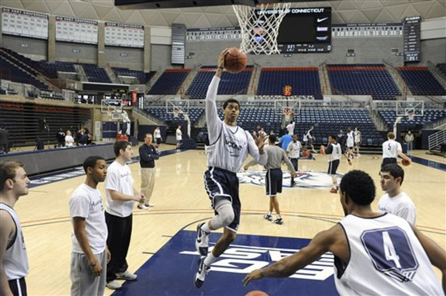 Connecticut freshman Jeremy Lamb, cente,r goes to the basket during practice in Storrs, Conn., Tuesday, March 29, 2011. Connecticut's junior star Kemba Walker gets most of the headlines, but the play of three freshmen, especially swingman Jeremy Lamb has been part of the Huskies' improbable run to the Final Four.  (AP Photo/Jessica Hill)