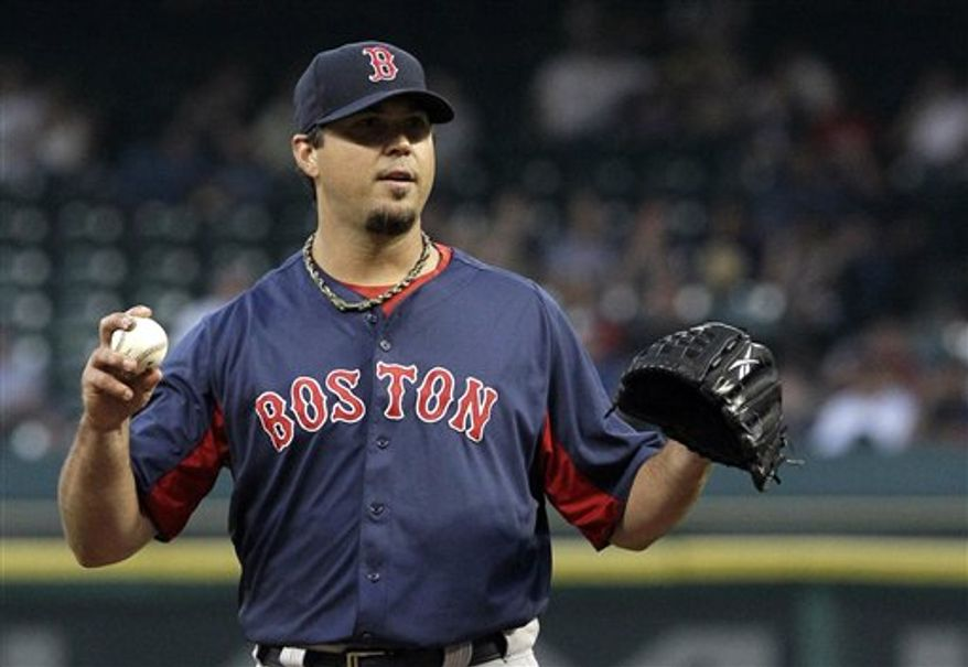 Boston Red Sox pitcher Josh Beckett waits for a batter to get ready during the first inning of an exhibition baseball game against the Houston Astros, Wednesday, March 30, 2011, in Houston. Beckett pitched five shutout innings, giving up only one hit. (AP photo/Pat Sullivan)