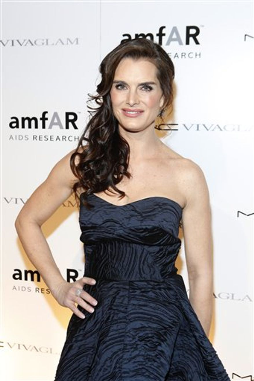 "FILE - In this Feb. 10, 2010 file photo originally released by MAC Cosmetics, actress Brooke Shields attends the amfAR New York Gala in New York.  Shields is set to replace Bebe Neuwith in the role of Morticia in the Broadway Musical, The Addams Family,"" beginning June 28, 2011. (AP Photo/MAC Cosmetics, David Goldman)"
