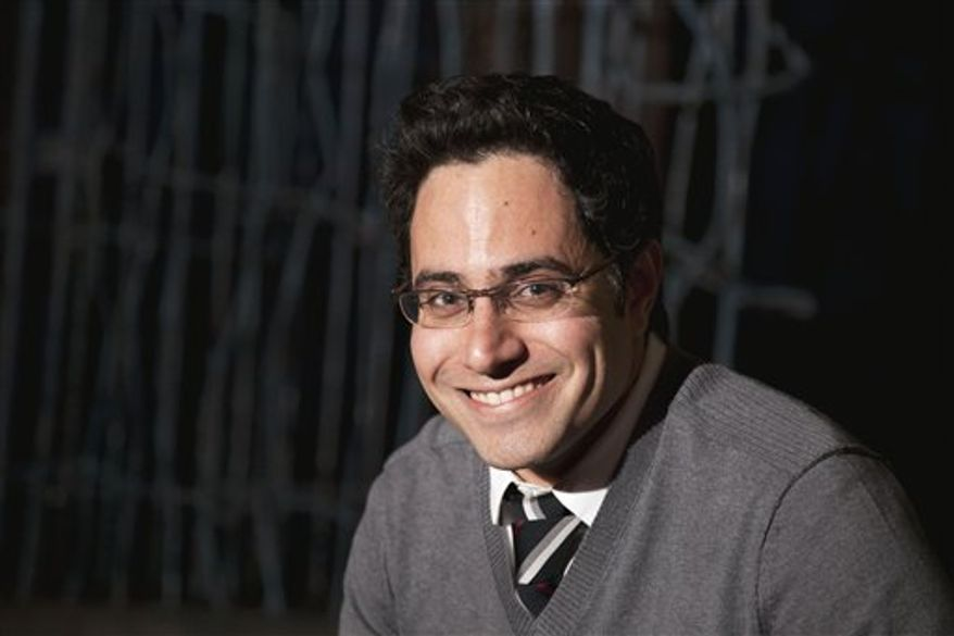 In this March 30, 2011 photo, playwright Rajiv Joseph poses for a portrait in New York. (AP Photo/Victoria Will)