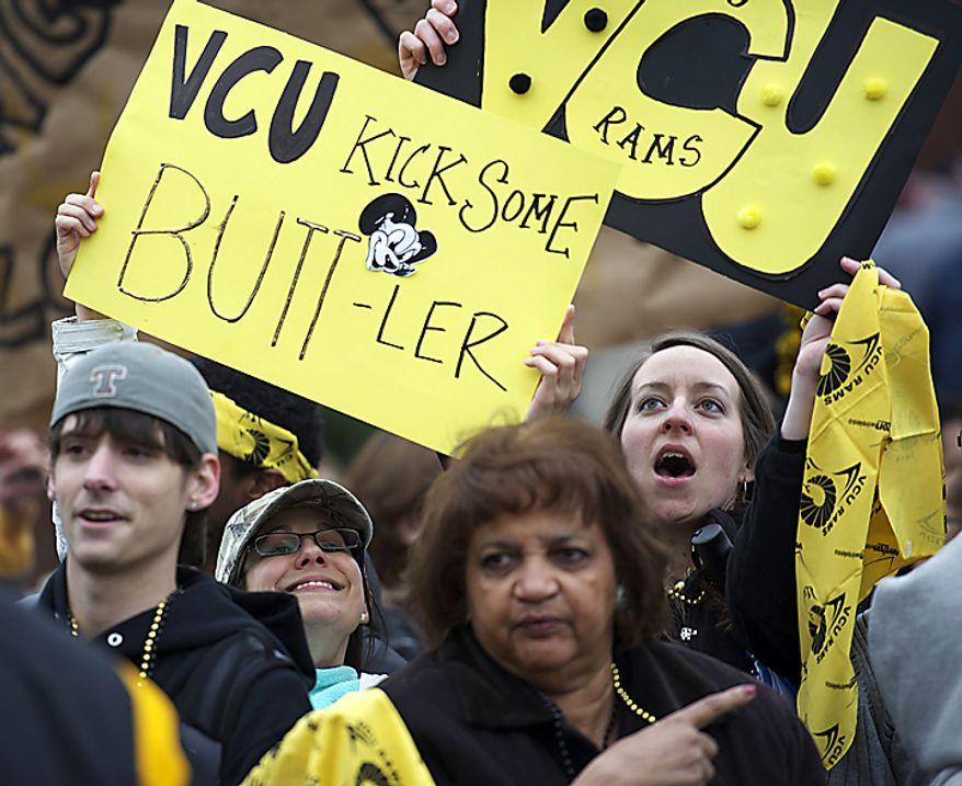 Virginia Commonwealth University graduate students Marisa Cosco (left) and Carrie Newcomb (right) join in a cheer as the crowd waits for the VCU men's basketball team to depart from the campus in Richmond on Wednesday, March 30, 2011, en route to Houston for the NCAA Final Four tournament. (Rod Lamkey Jr./The Washington Times)