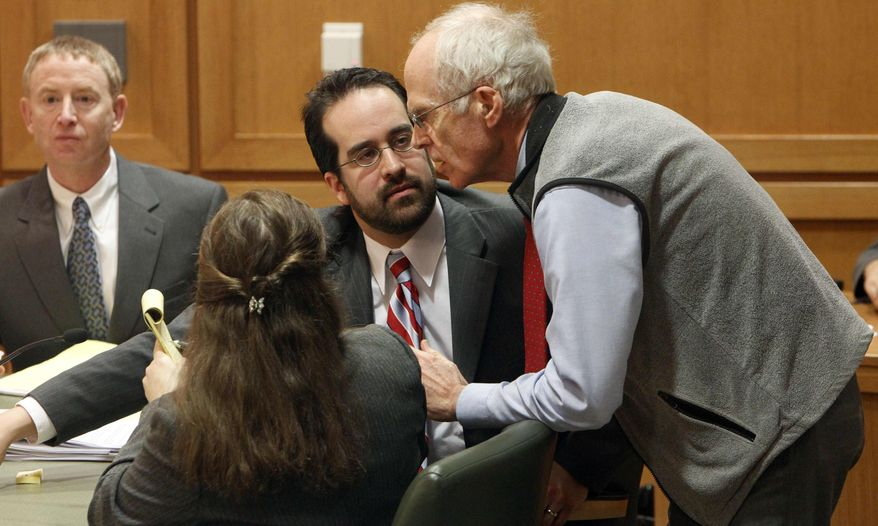 ** FILE ** Wisconson Secretary of State Douglas La Follette, right, confers with assistant attorneys general Maria Lazar, foreground, and Steven Kilpatrick, center, after a judge issued a temporary restraining order Friday, March 18, 2011, barring the publication of a controversial new law that would sharply curtail collective bargaining for public employees during a hearing in Dane County Court in Madison, Wis. (AP Photo/Pool, Mark Hoffman)