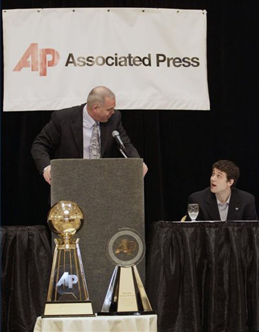 BYU coach Dave Rose talks to BYU's Jimmer Fredette, left, and at a news conference Friday, April 1, 2011, in Houston. Fredette is AP player of the year, while Mike Brey, of Notre Dame, was selected AP coach of the year. (AP Photo/Eric Gay)