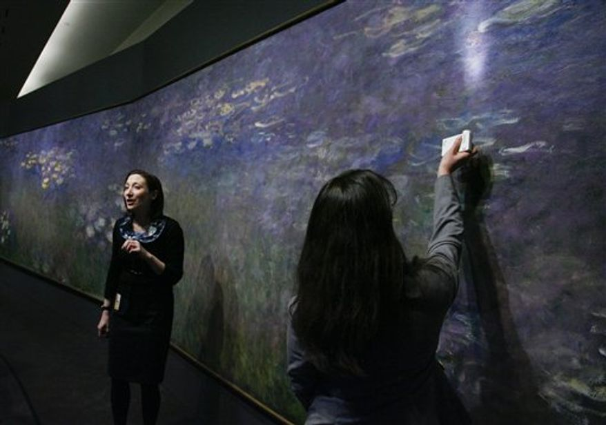"""Director and CEO of the Nelson-Atkins Museum of Art, Julian Zugazagoitia, talks to the media about Claude Monet's """"Water Lilies"""" exhibit during a press preview, Friday, April 1, 2011, in Kansas City, Mo. For the first time in 30 years the three panel work of the Impressionist artist will be on display at the museum and will run from April 9 through August 7, 2011. (AP Photo/Ed Zurga)"""