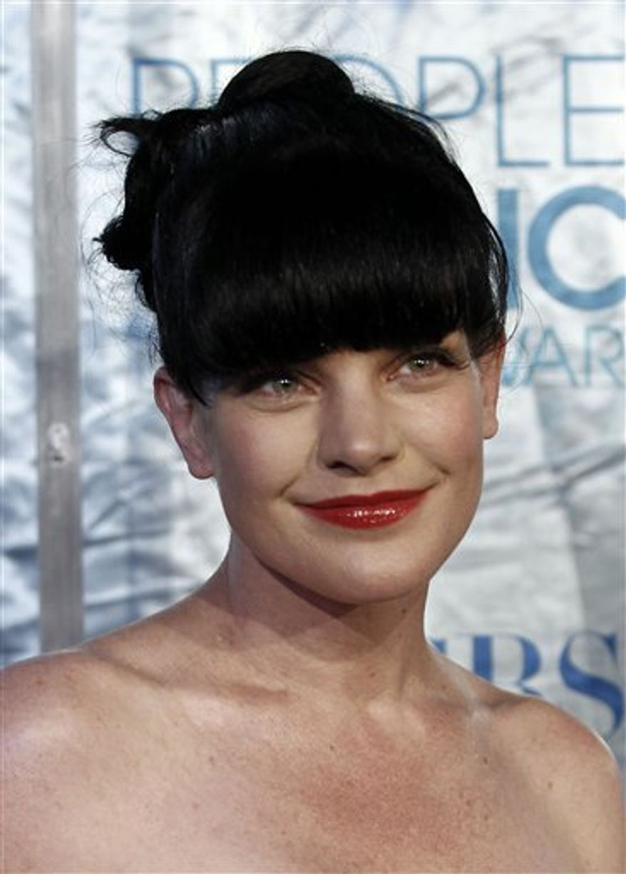 """Actress Pauley Perrette, from the CBS series,""""NCIS,"""" arrives at the People's Choice Awards in Los Angeles, in this Jan. 5, 2011, file photo. (AP Photo/Matt Sayles, file)"""