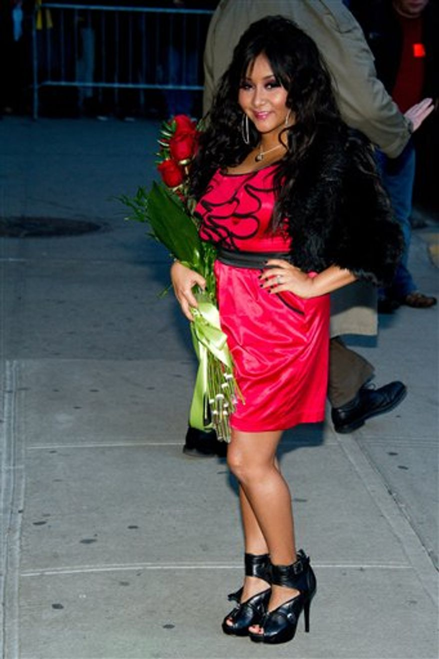"FILE - Nicole 'Snooki' Polizzi leaves a taping of the ""Late Show with David Letterman"" in New York, in this Jan. 10, 2011 file photo. The Rutgers University Programming Association paid Nicole ""Snooki"" Polizzi of the reality TV show ""Jersey Shore"" $32,000 Thursday March 31, 2011 to dish on her hairstyle, fist pumps, as well as the GTL _ gym, tanning, laundry_ lifestyle. That's $2,000 more than the $30,000 the university is paying Nobel-winning novelist Toni Morrison to deliver Rutgers' commencement address in May. (AP Photo/Charles Sykes, File)"