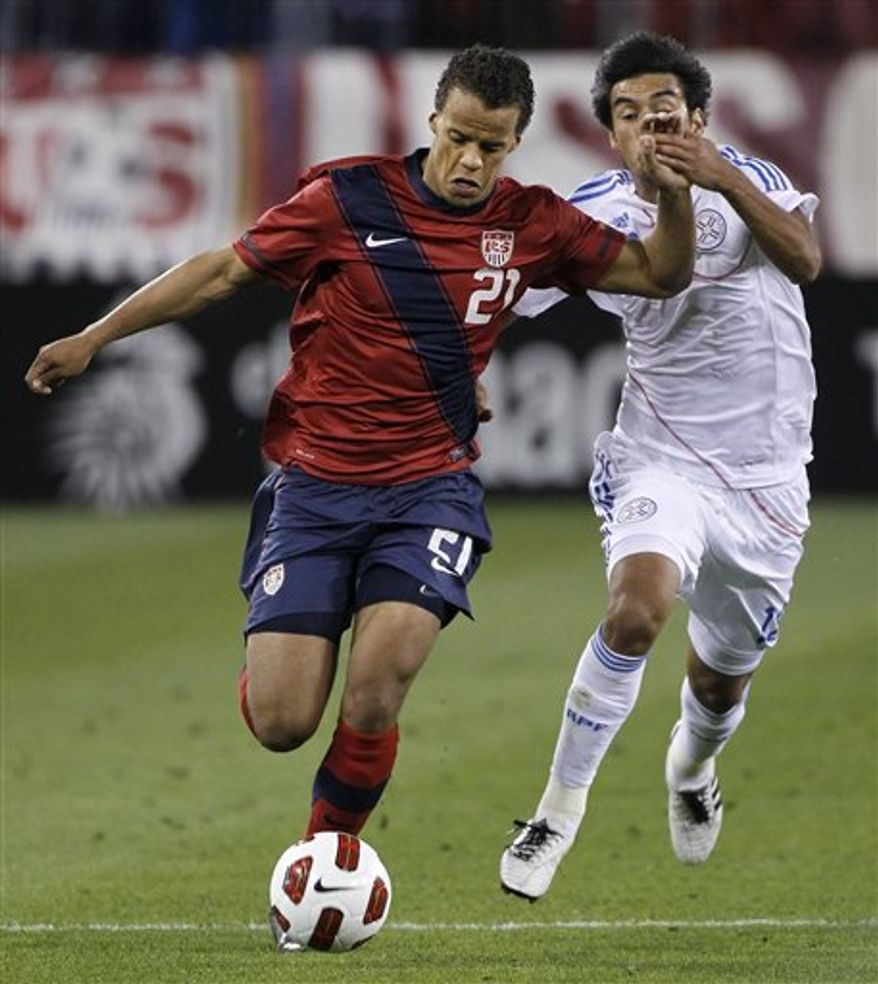 """FILE - In this March 29, 2011 file photo, United States defender Timothy Chandler (21) is chased by Paraguay midfielder Marceol Estigarribia (18) during the first half of an international friendly soccer match in Nashville, Tenn. Chandler, the son of an American serviceman and a German mother, says playing the U.S. national team is a """"dream come true."""" (AP Photo/Mark Humphrey, File)"""