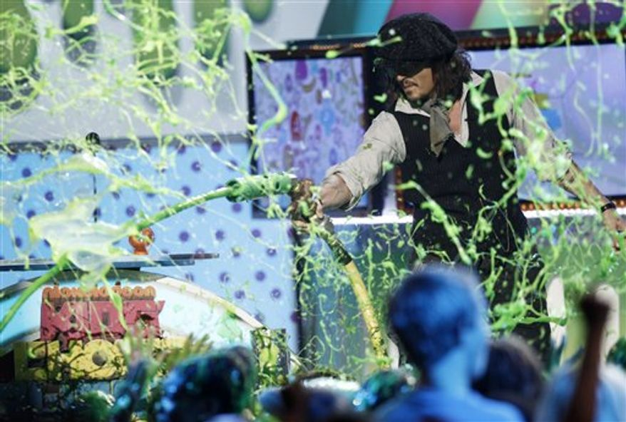 """The Black Eyed Peas accepts the award for """"Favorite Music Group"""" at Nickelodeon's 24th Annual Kids' Choice Awards on Saturday, April 2, 2011, in Los Angeles. (AP Photo/Matt Sayles)"""