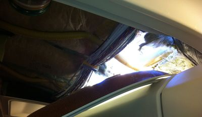 This photo provided by passenger Christine Ziegler shows an apparent hole in the cabin on a Southwest Airlines aircraft Friday, April 1, 2011, in Yuma, Ariz. Authorities say the flight from Phoenix to Sacramento, Calif., was diverted to Yuma due to rapid decompression in the plane. (AP photo/Christine Ziegler)