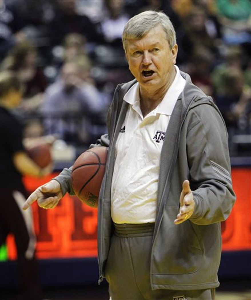 Texas A&M head coach Gary Blair looks on as guard Sydney Carter speaks during a press conference before the women's NCAA Final Four national championship college basketball game in Indianapolis, Monday, April 4, 2011. Texas A&M faces Notre Dame in Tuesday's  game. (AP Photo/Mark Duncan)
